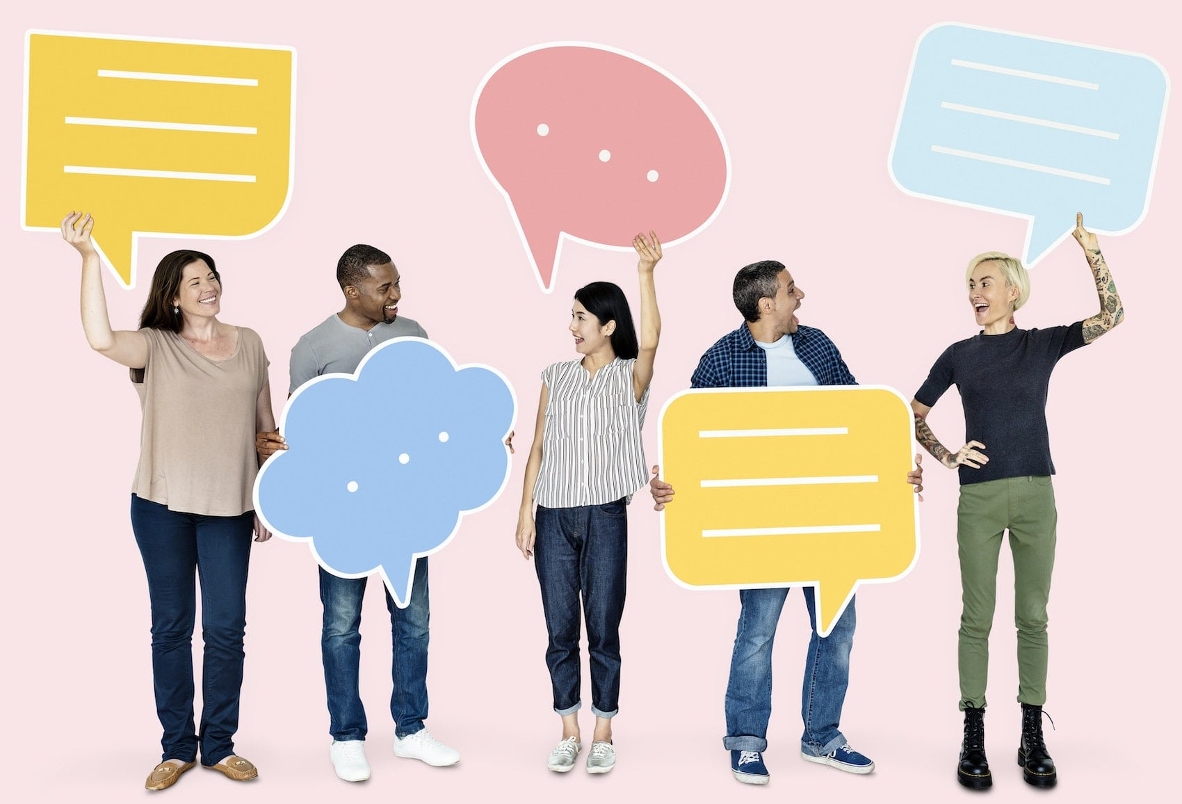Group of people golding up speech bubble cut outs