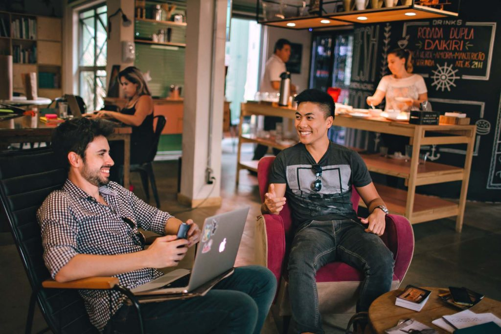 Two sales reps sitting in the lounge and chatting