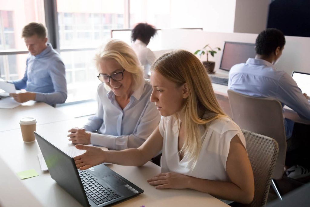 Manager and sales rep reviewing a call together at a desk