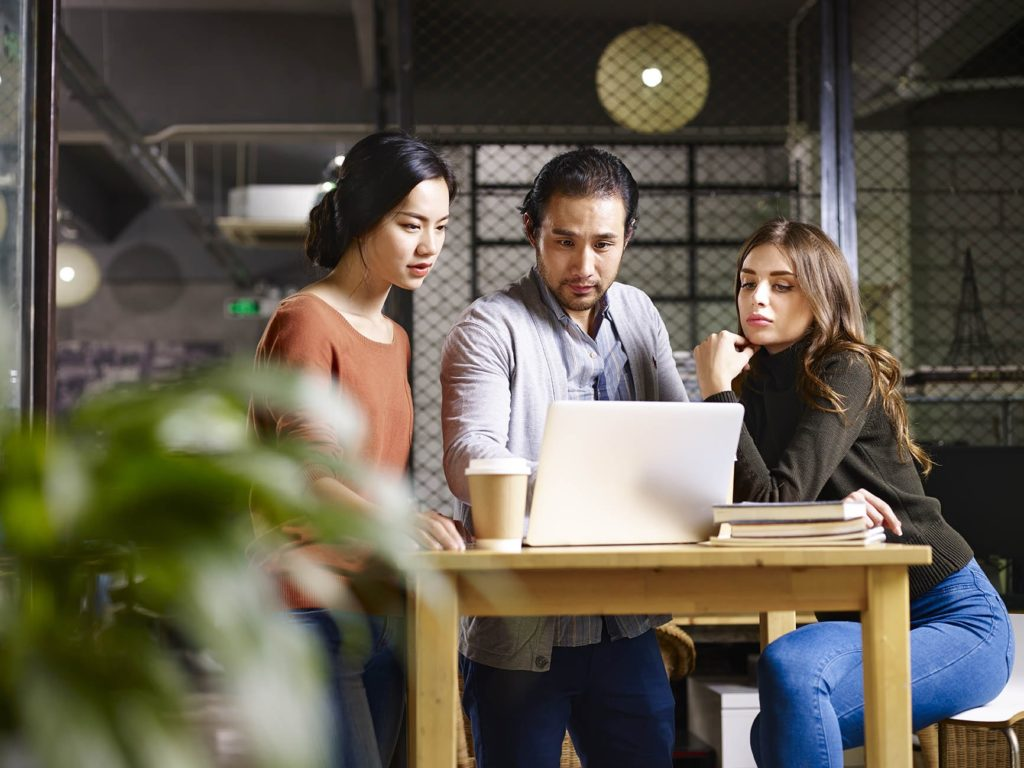 Three sales team members reviewing lead qualification